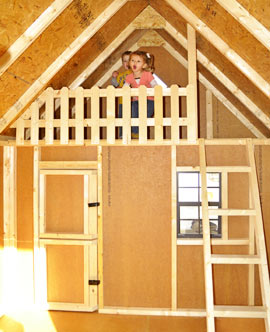 Loft inside a clubhouse playhouse from Pine Creek Structures